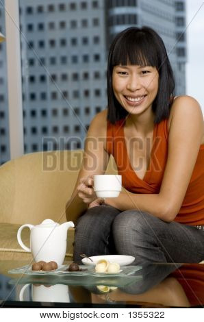 Woman Having Tea