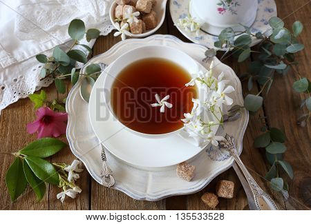 Decorative composition of vintage style: romantic tea drinking with jasmine tea