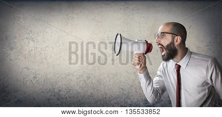 a man speaks to megaphone, announcement concept
