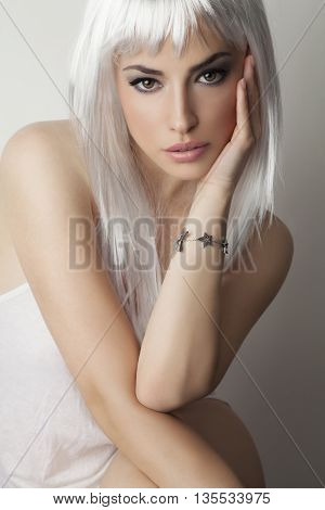 beautiful platinum hair young woman studio portrait white background