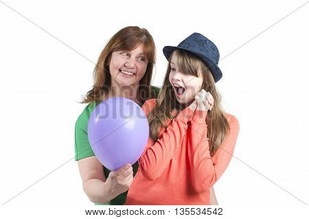 Woman unexpectedly gave the girl a balloon. Studio photography on a white background.