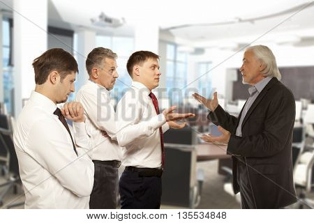 Business conflict concept. Four businessman are trying to come to an agreement
