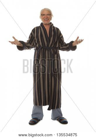 Full length portrait of a relaxed senior man in a blue bathrobe smiling and looking at the camera isolated on white background