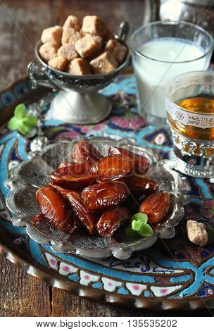 Oriental composition: ripe dates green tea and fermented milk drink