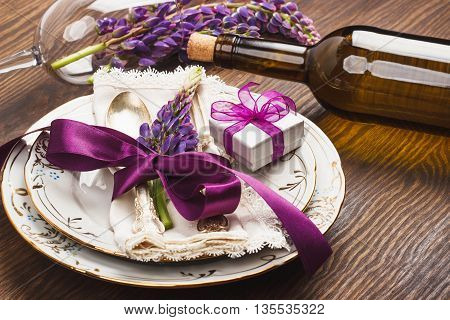 Tableware With Violet Lupinus And Silverware