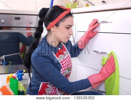 Girl Wiping Kitchen Furniture