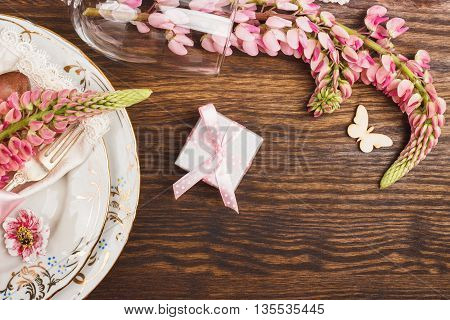 Tableware With Pink Lupinus And Silverware
