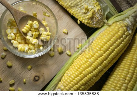 Corn and corn slide in a cup with wooden spoon