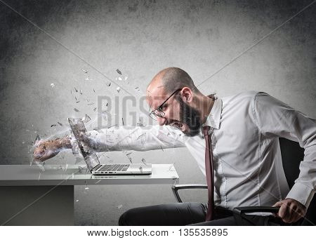 explosion of anger, an employee breaks the screen of a computer