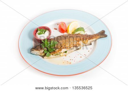 Whole baked fish served with sour cream and vegetables