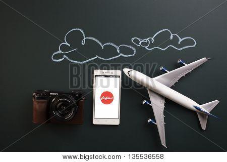 Kual Lumpur,Malaysia 19th Jun 2016,air asia mobile apps with toy aeroplane