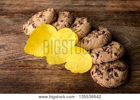 american cookies and yellow leaves on wood