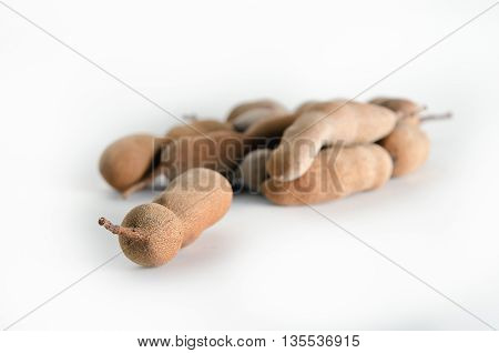 Tamarind or bitter gourd (Other names are Cucurbitaceae bitter gourd balsam apple balsam pear bitter cucumber bitter melon tamarind) isolated on white background