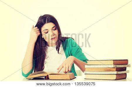 Teenage girl studying at the desk