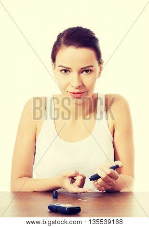 Woman taking sugar level test