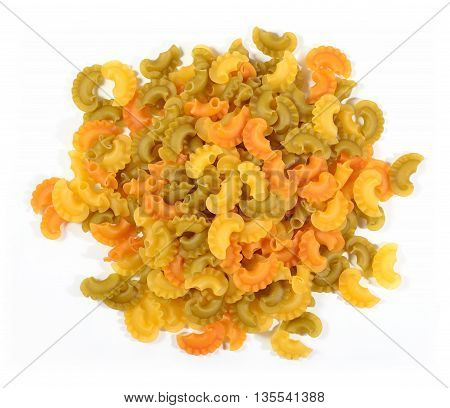 Heap Of Colored Uncooked Italian Pasta On A White