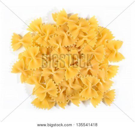 Heap Of Uncooked Italian Pasta Farfalle On A White