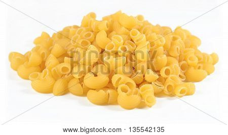 Heap Of Uncooked Italian Pasta Pipe Rigate On A White