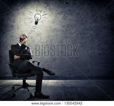 turn on idea - businessman has a good idea