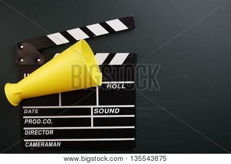 clapper board and megaphone on the blackboard