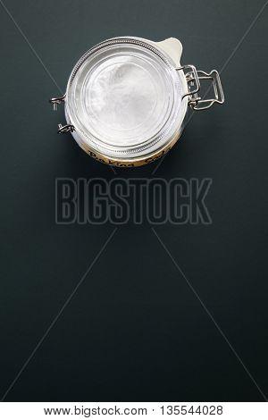 top view of baking soda in a jar on the blackboard