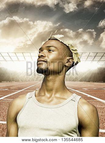 Portrait of victorious sportsman against race track