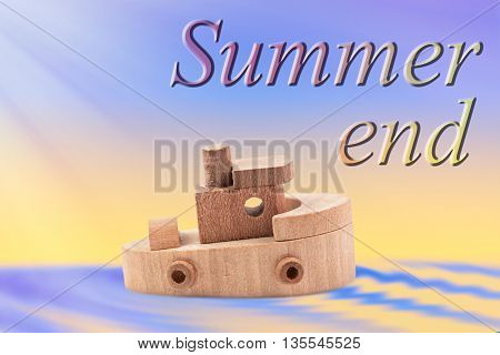 summer end written with wooden ship toy