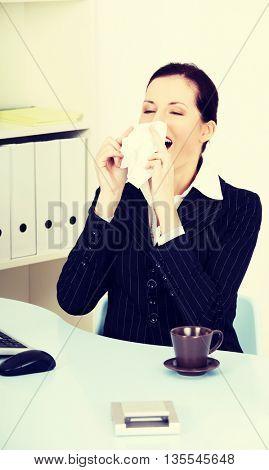 Sneezing woman.
