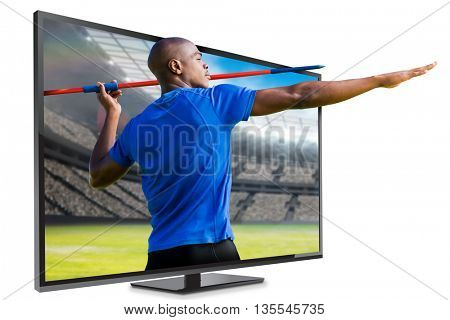 Profile view of sportsman practicing javelin throw against view of a stadium
