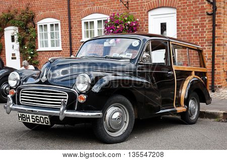 AMERSHAM, UK - SEPTEMBER 13: A vintage Morris Traveller station wagon is parked on the side of the highway as a static display at the Amersham Heritage Day festival on September 13, 2015 in Amersham.