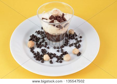 chocolate pudding with with chocolate chips and hazelnuts