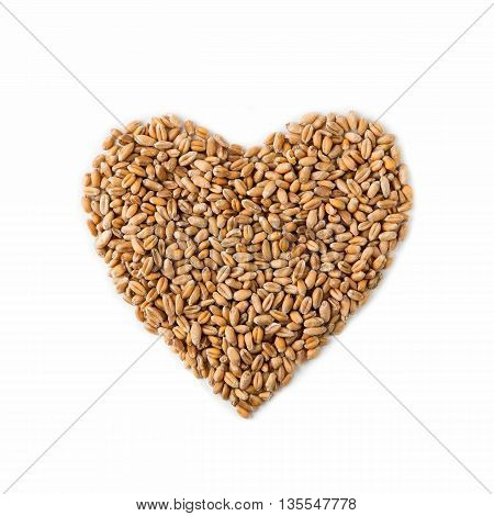 Isolated heart shape from ripe wheat grain, seeds on white background