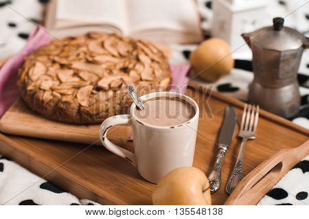 Cup of coffee stay on wooden tray with apple pie closeup. Homemade cake. Good morning. Selective focus.