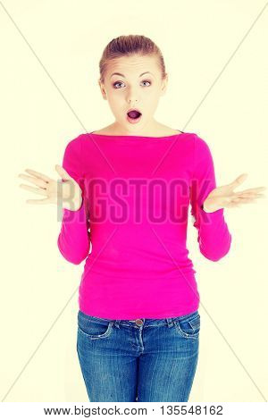 Beautiful casual woman expresses shock.