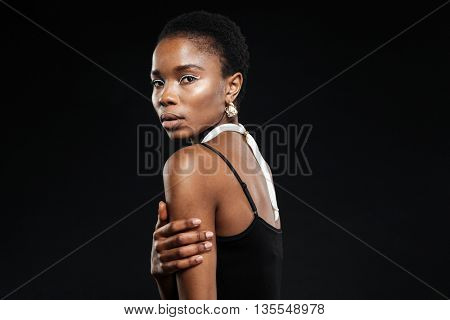 Close-up portrait of a beautiful young african girl isolated on the black background