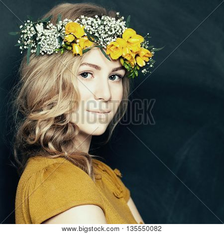Young fashion woman in yellow with flowers
