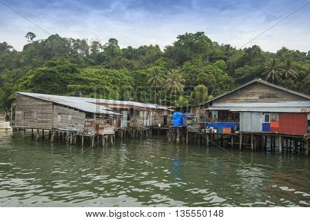 Poor fishing village on stilts over sea. Places like this are at risk from rising sea levels, climate change and global warming,
