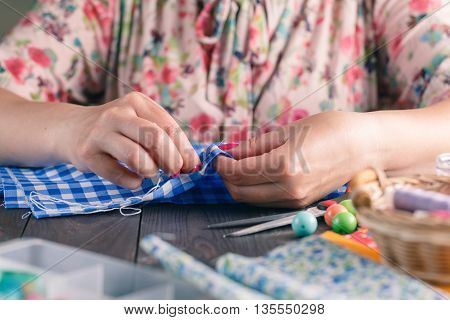 Hand For Sewing From Woman Hand