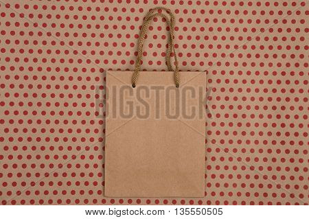 Celebratory Concept - Handmade Striped Shopping Bag, Gift Bags On Craft  Paper Background In Red Pol
