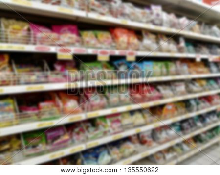 defocused blurry lane with candy in Supermarket