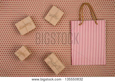 Celebratory Concept Of Craft Paper With Striped Shopping Bag, Gift Bags On Craft  Paper Background I