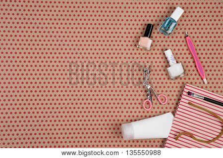 Striped Gift Bag With Cosmetics Set For Make-up On Craft  Paper Background