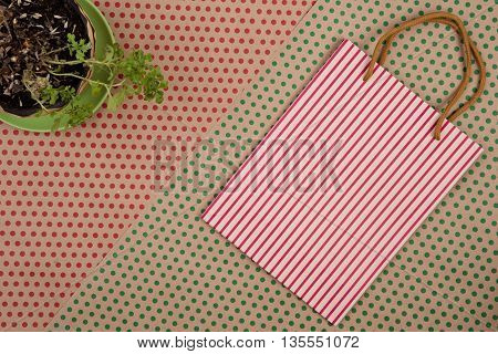 Striped Shopping Bag, Gift Bags And Flower On Craft  Paper Background In Red And Green Polka Dots