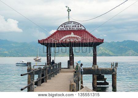Gili Air, Indonesia - May 6, 2013 - Pier for boats doing island hopping between Lombok, Gili Air, Meno and Trawangan islands