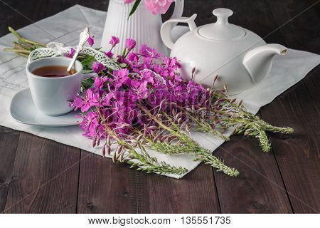 Summer Tea With White Flowers Served On The Table