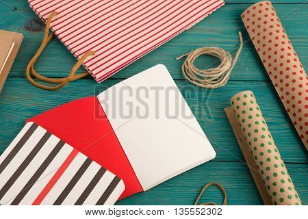 Set With Handmade Striped Shopping Bag, Packing Paper With Polka Dots, Notepads On Blue Wooden Backg