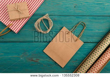 Set With Handmade Striped Shopping Bag, Gift Bags, Packing Paper With Polka Dots On Blue Wooden Back