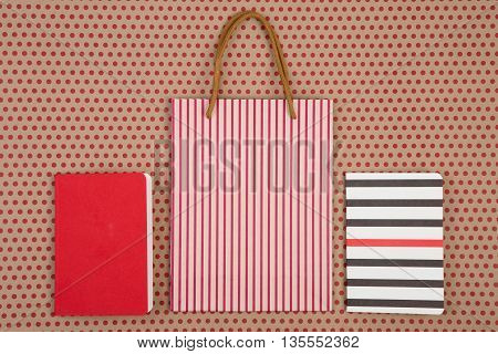 Handmade Striped Shopping Bag, Gift Bags And Notepads On Craft  Paper Background In Red Polka Dots