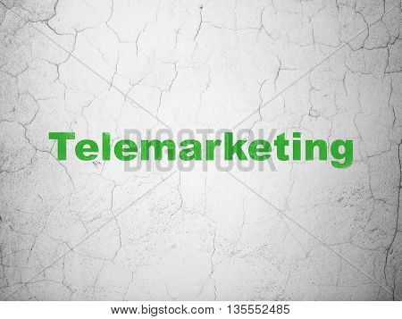 Advertising concept: Green Telemarketing on textured concrete wall background
