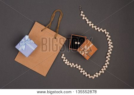 Gift Bag, Gift Boxes In Polka Dots With Pearl Jewelry On Grey Background